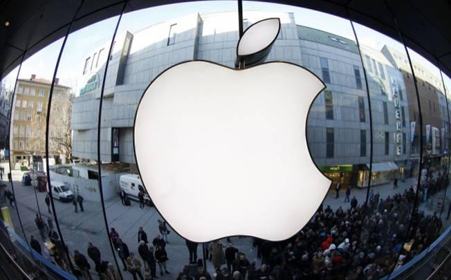 Apple shares fall below $400