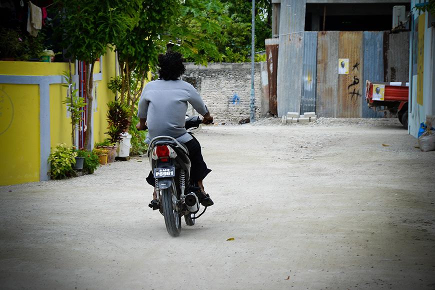 biker-riding-away