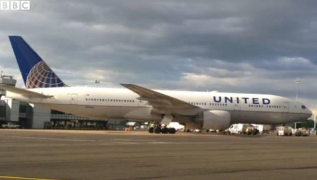 Flight Attendant Opens Emergency Slide