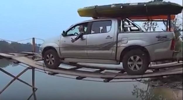 Truck Drives Across Wooden Bridge