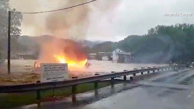 Burning House Floats Down A Creek