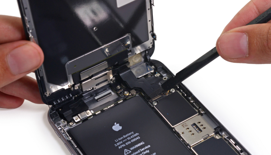 iPhone 6s Plus teardown: Rear camera modules can be observed near the top right side of the phone.