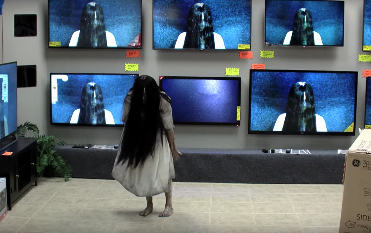 watch the girl from �the ring� crawl out of a tv and scare
