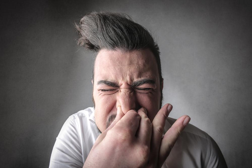 Holding in sneeze emergency room visit
