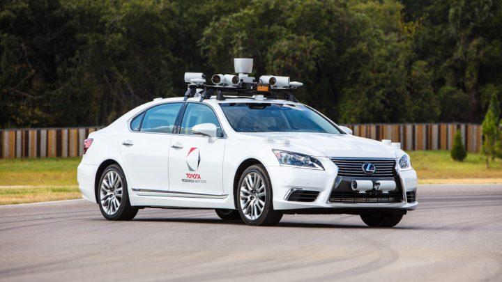 Toyota self-driving cars research vs Tesla