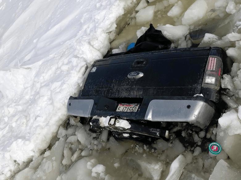 truck falls through ice