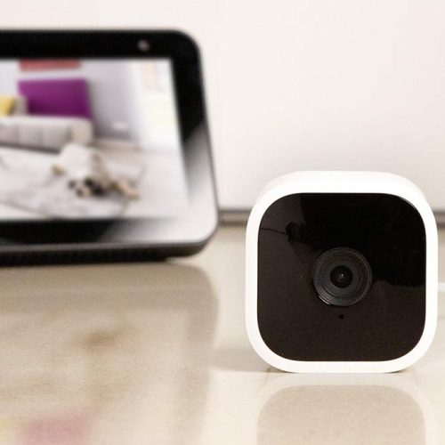 Amazon's Blink Mini home security camera next to an Echo Show 5