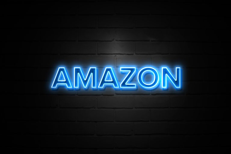 Amazon logo in blue on a black background with brick texture