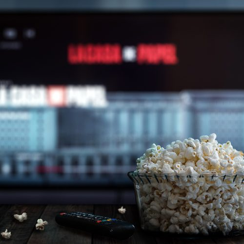 Netflix on a TV with a bowl of popcorn