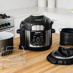 The Ninja Foodi FD401 multi-use cooker with built-in air frying on a table