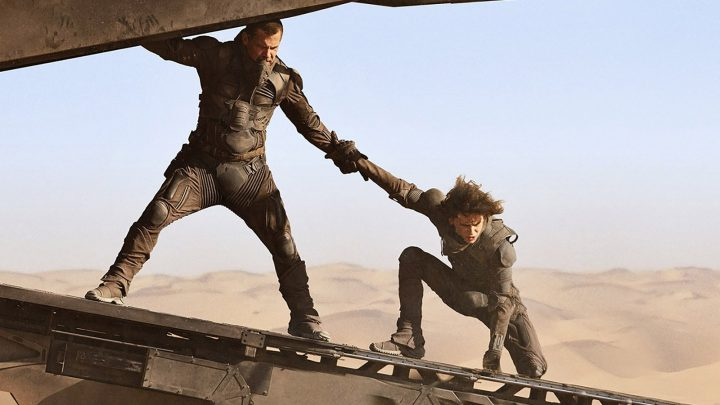 A man and woman holding hands in HBO Max Dune