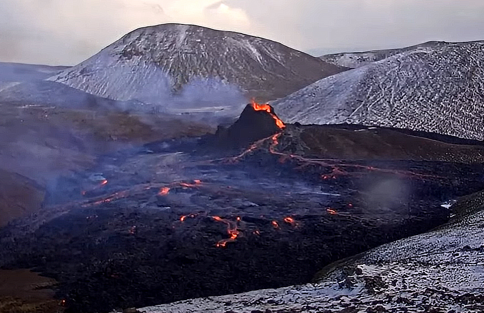Watch as a drone explores Iceland's erupting volcano thumbnail