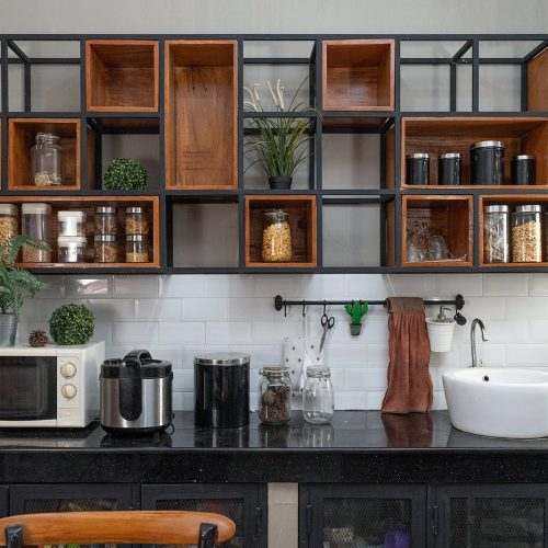A kitchen with modern storage and various appliances on the counter