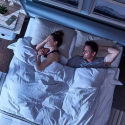A couple sleeping soundly in bed