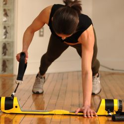 A woman using the MAXPRO cable gym to work out at home