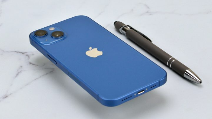 Blue Apple iPhone 14 on a marble table