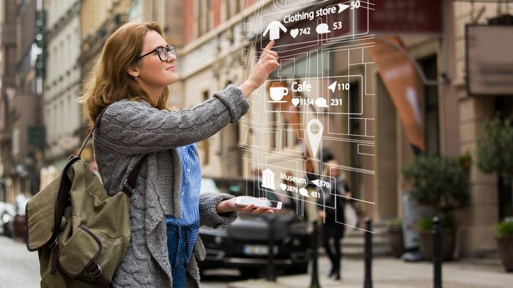 A woman uses the augmented reality features on her AR glasses